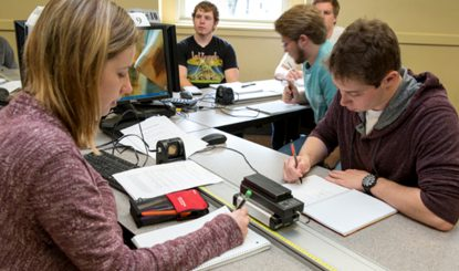 students taking notes during classroom experiment