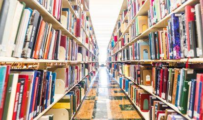 long aisle of book shelves